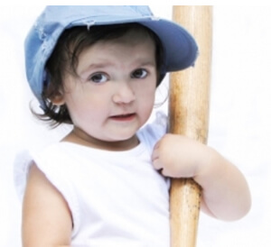 child supporting her bat