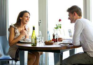photo: couple having romantic dinner before prenup