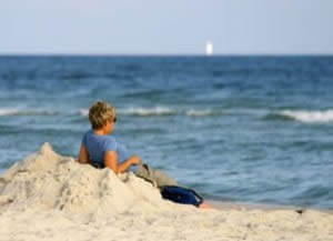photo: relaxed woman on beach after divorce recovery