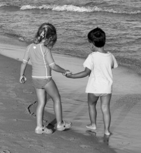 photo: brother and sister at beach needing retroactive child support