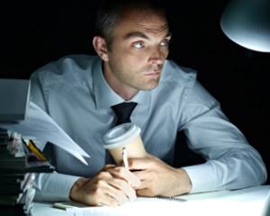 photo: man at work late considers paternity disestablishment
